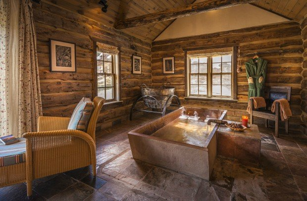 A luxury ghost town vacation resort cabin obsession for Hand hewn log cabin kits