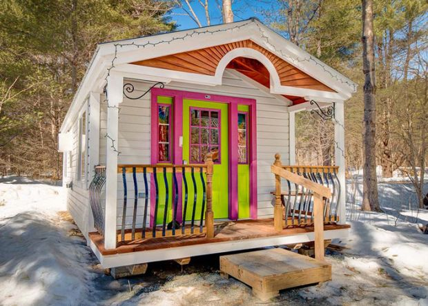 12x26-apple-blossom-cottage-sunburst-arch-porch-steel-railing-tiny-house-green-purple-door-four-season-turn-key