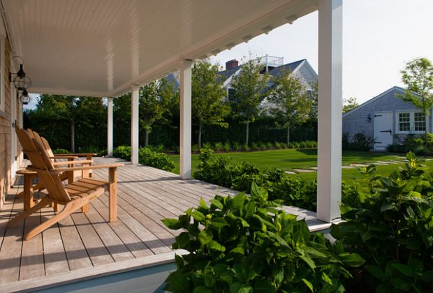 Deck.-Back-porch-deck-ideas.-The-decking-material-is-Garapa-Gold.-Porch-BackPatio-Deck-DeckMaterial.-Jonathan-Raith-Inc.