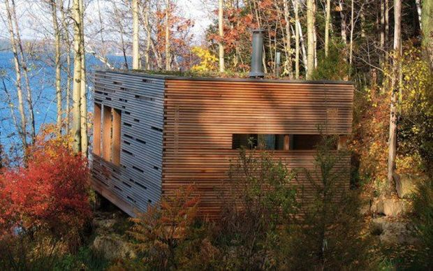 sunset-cabin-canada-green-roof-568x355