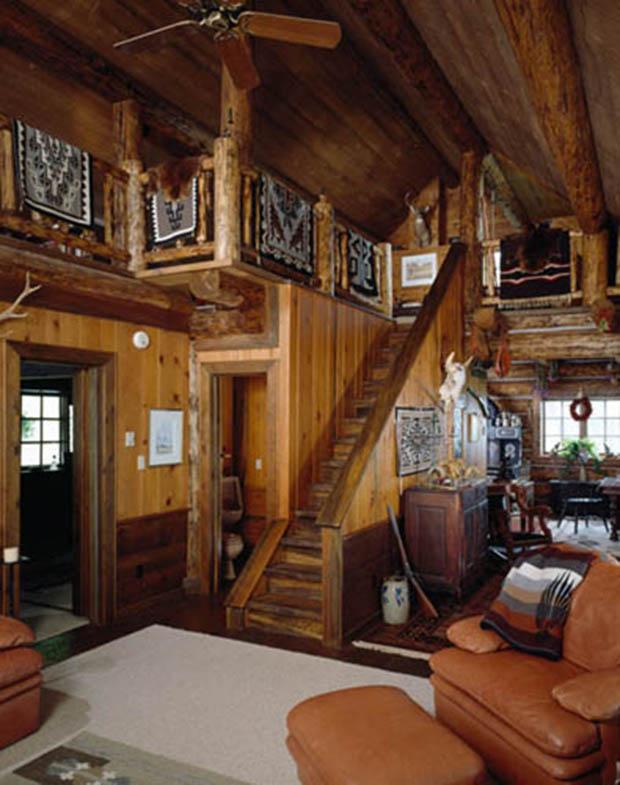 Interior, vertical, living room toward kitchen, Schuman residence, Woods Bay, Montana; Montana Log Homes