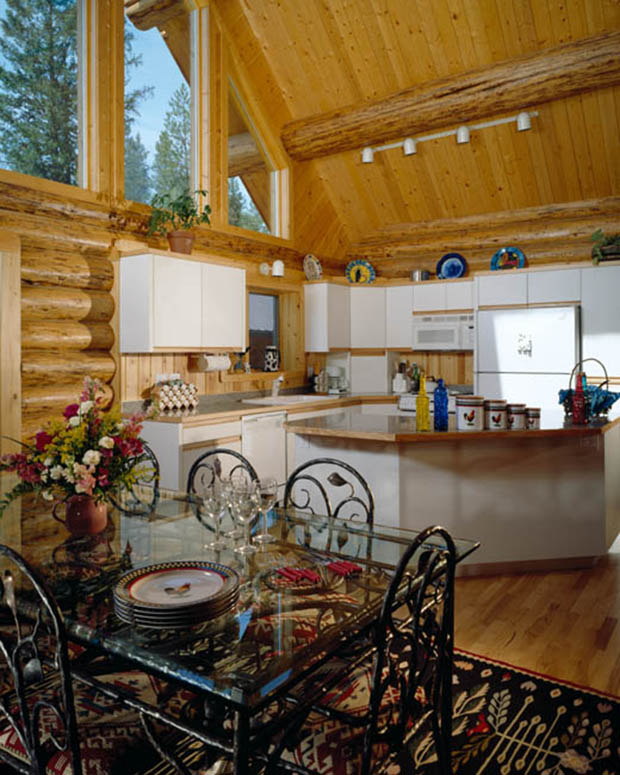 Interior, vertical, dining room and kitchen, Goodson residence, Bigfork, Montana; Montana Log Homes