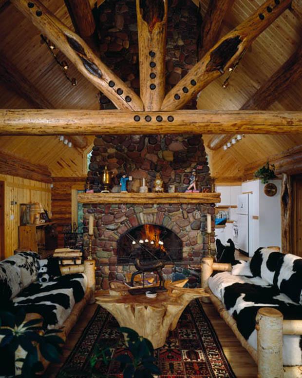 Interior, vertical, living room towards fireplace, Goodson residence, Bigfork, Montana; Montana Log Homes