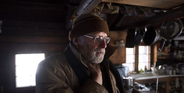 "WALDO, MAINE --01/14/2016 -- Lee Stover in his cabin that has no electricity or running water on his Waldo property.  The cabin was built by his father in the 1950's and his family made many trips each year to spend time there.  The 70-year-old retired forester moved into the cabin 16 years ago.  He harvests logs from his property and saws lumber to sell. ""There is a fair amount effort just living [here], but I wouldt want to have it any other way."" he said. Gabor Degre 