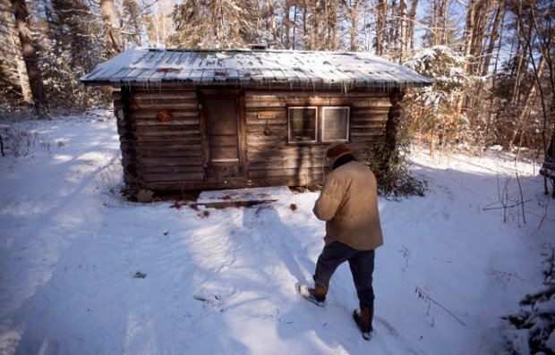 "WALDO, MAINE --01/14/2016 -- Lee Stover heads to his cabin that has no electricity or running water on his Waldo property. The cabin was built by his father in the 1950's and his family made many trips each year to spend time there. The 70-year-old retired forester moved into the cabin 16 years ago. He harvests logs from his property and saws lumber to sell. ""There is a fair amount effort just living [here], but I wouldt want to have it any other way."" he said. Gabor Degre 