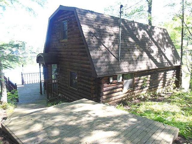[FOR SALE] THIS CHARMING LAKEFRONT LOG CABIN